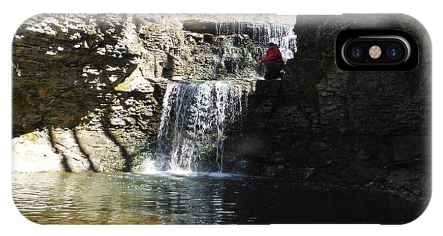 Man On A Waterfall Ledge IPhone X Case featuring the photograph Man On A Waterfall Ledge by Paddy Shaffer