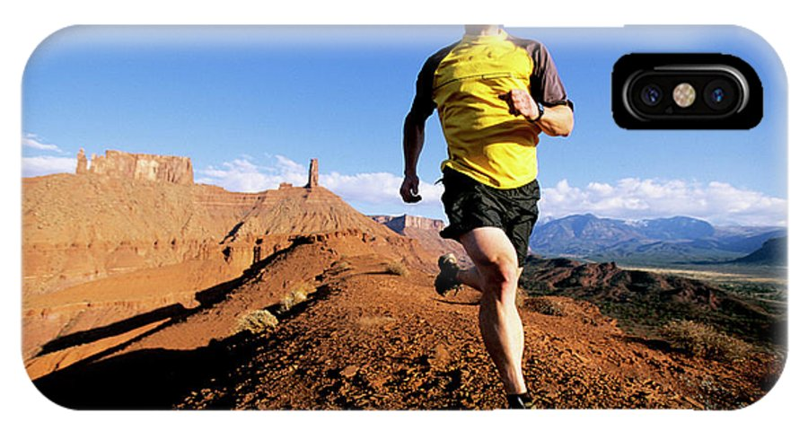 Action IPhone X Case featuring the photograph Man Running In Moab, Utah by Scott Markewitz