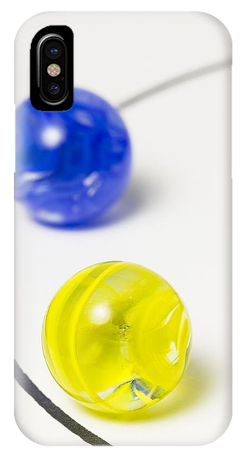 Marbles IPhone X Case featuring the photograph Marbles Yellow Blue Curve 1 by John Brueske