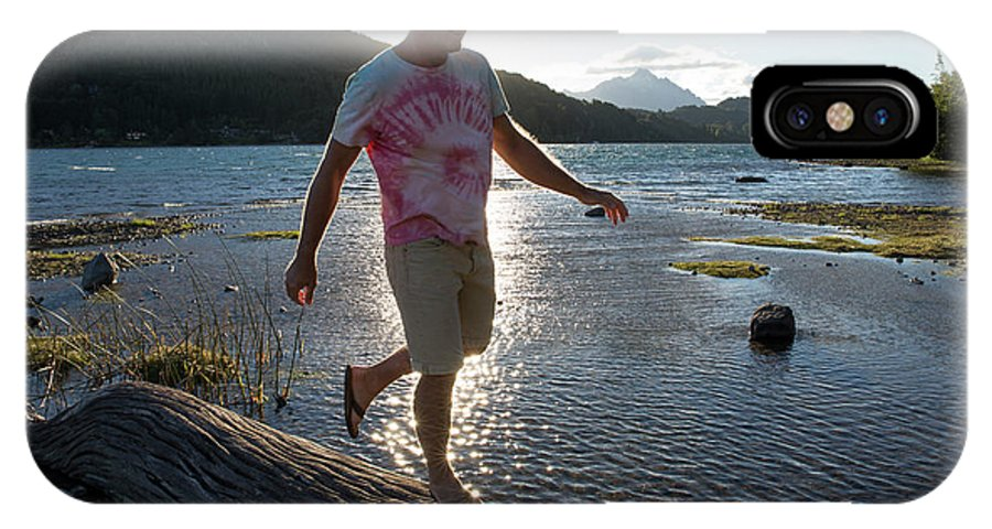 Weather IPhone X Case featuring the photograph Mature Man Balances Along Log by Philip & Karen Smith / TFA
