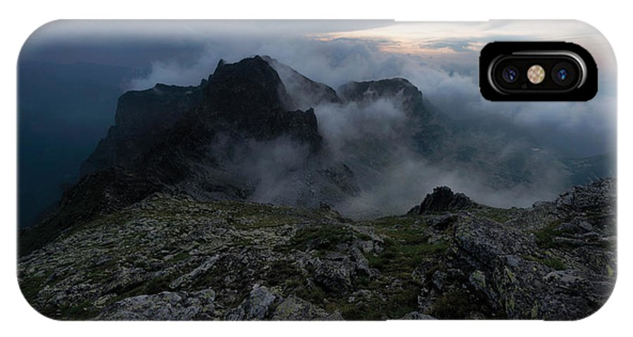 Whiff IPhone X Case featuring the photograph Misty Peaks And A Whiff Of Danger by Branislav Brankov
