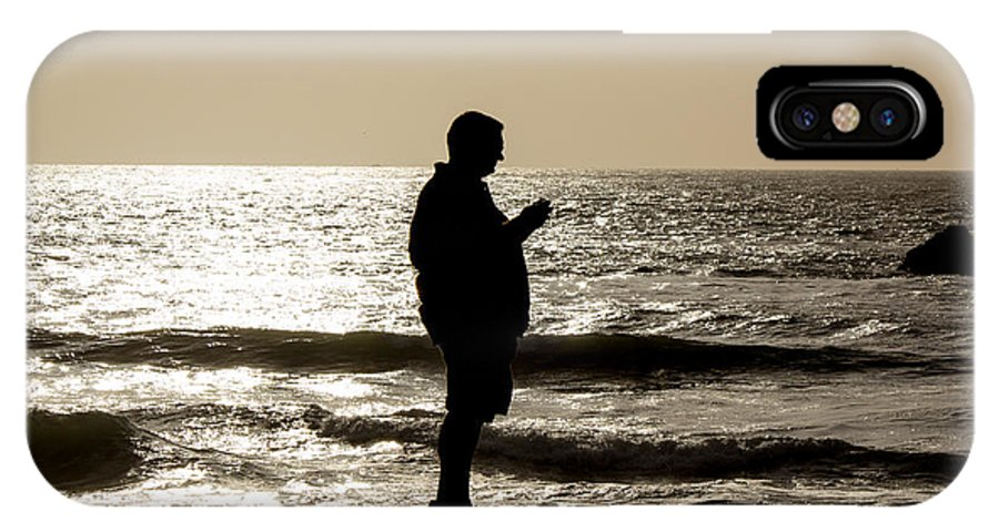Ocean IPhone X Case featuring the photograph Modern Man Looking At Smart Phone by Glen Laughton