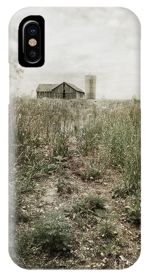 Drive; Driveway; Path; Dirt; Gravel; Farm; Grasses; Weeds; Barn; Outside; Outdoors; Day; Nature; Vintage; Old; Worn; Sky; Clouds; Rural; Land; Wood; Tree; Leaves; Abandoned; Silo; Grey; Gray IPhone X Case featuring the photograph Off In The Distance by Margie Hurwich