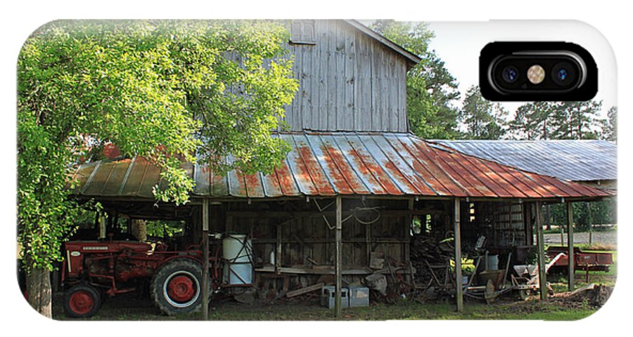 Barn IPhone X Case featuring the photograph Old Barn with Red Tractor by Suzanne Gaff