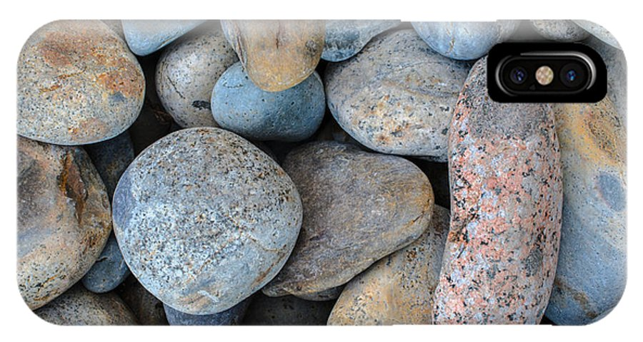 Rocks IPhone X Case featuring the photograph On The Rocks by John Munno