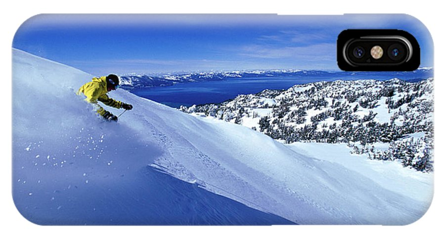 Action IPhone X Case featuring the photograph One Man Skiing In Powder High by Corey Rich