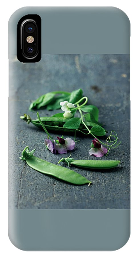 Fruits IPhone X Case featuring the photograph Pea Pods And Flowers by Romulo Yanes