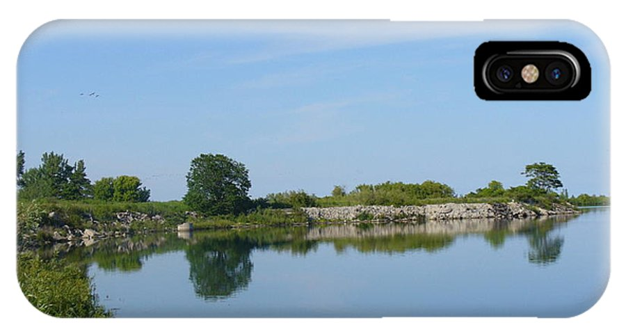 Man Made Penisula IPhone X Case featuring the photograph Peaceful Water Reflection At Tommy Thompson Park by Lingfai Leung