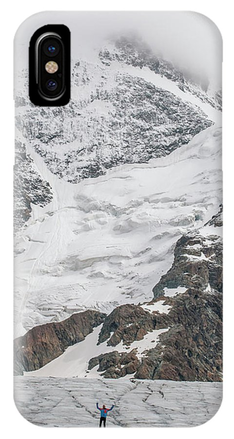 Winter IPhone X Case featuring the photograph Person Cheering On A Glacier by Thomas Bekker