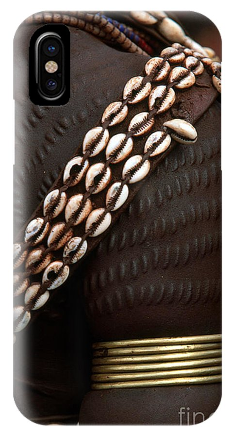 Vertical IPhone X / XS Case featuring the photograph Person Showing Cowry Shell Detail by Art Wolfe