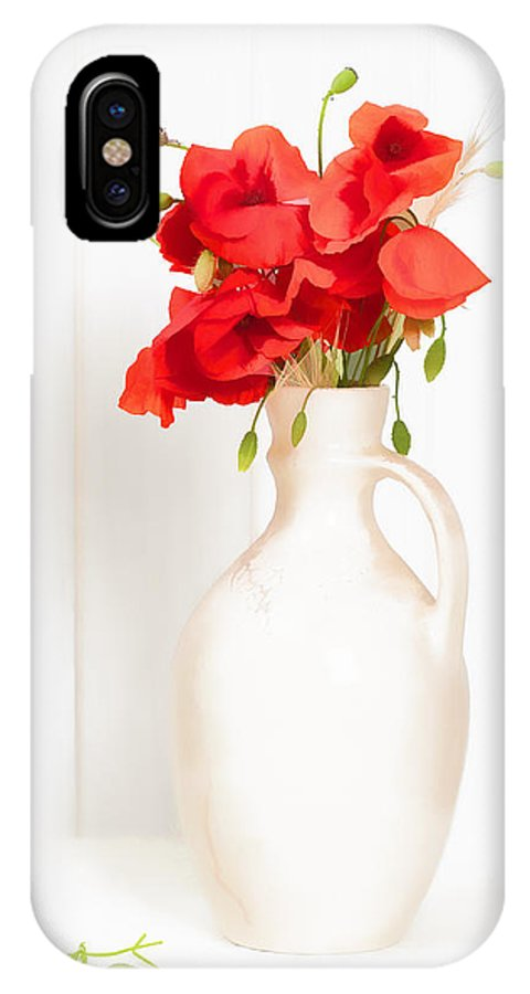 Poppy; Poppies; Bright; Red; Vase; Antique; Jug; Table; White; Background; Flowers; Floral; Display; Rustic; Stems; Seedheads; Buds; Green; Spring; Summer; Wild; Flower; Petals IPhone X Case featuring the photograph Poppies by Amanda Elwell