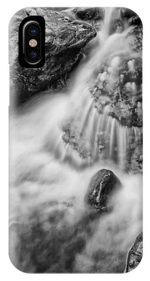 Black And White IPhone X Case featuring the photograph Puddle On The Rock Bw by Mitch Johanson