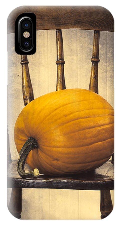 Pumpkins IPhone X Case featuring the photograph Pumpkin On Chair by Amanda Elwell