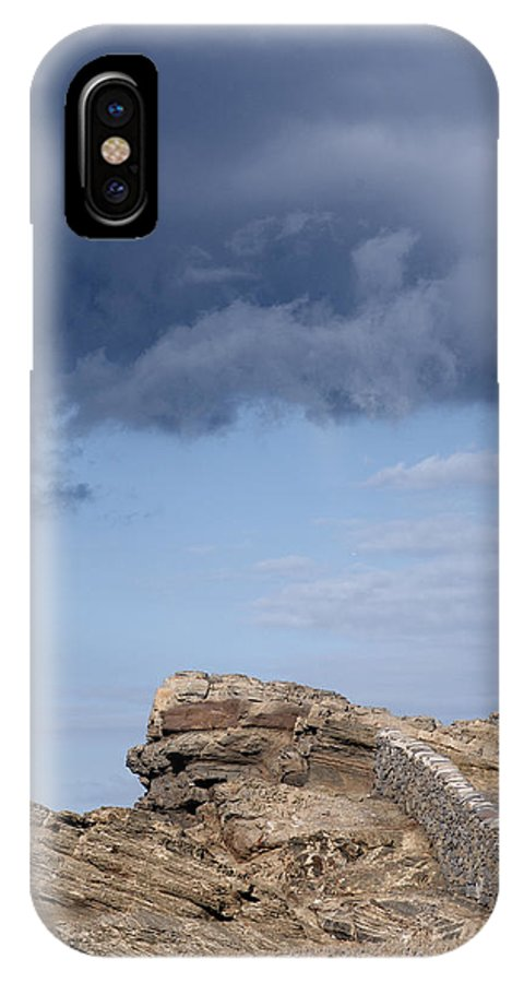 Ancient IPhone X Case featuring the photograph Cala Mesquida Stone Wall Against Rocks With A Stormy Sky Above - Putting Walls To Heaven by Pedro Cardona Llambias