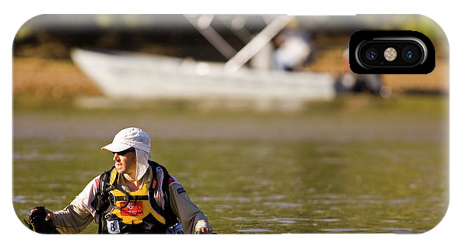 Action IPhone X Case featuring the photograph Racer Wading Across A River In An by Corey Rich
