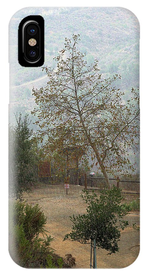 Rain On Trail IPhone X / XS Case featuring the photograph Rain On Trail by Viktor Savchenko