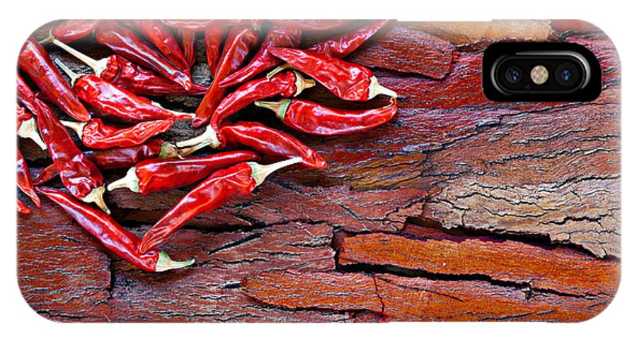 Food IPhone X Case featuring the photograph Red Chillies On Rustic Background by Ken Biggs