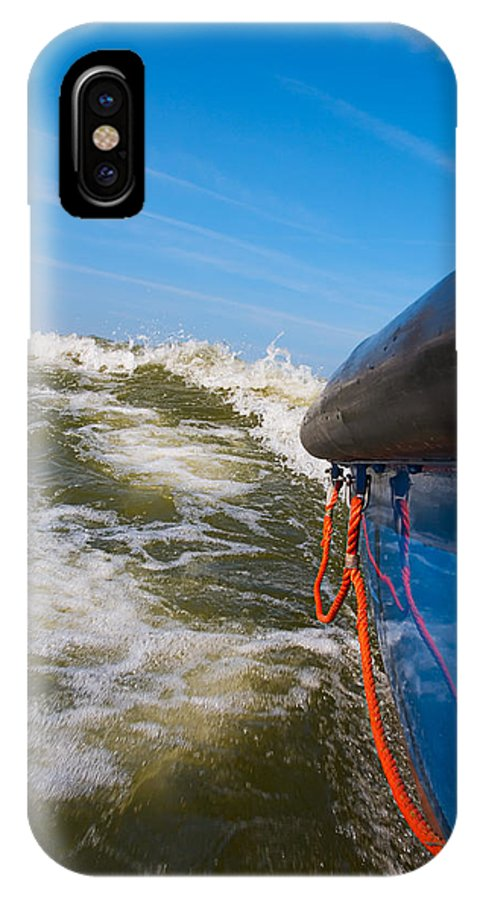 Adventure IPhone X Case featuring the photograph Riding The Storm. by Jan Brons