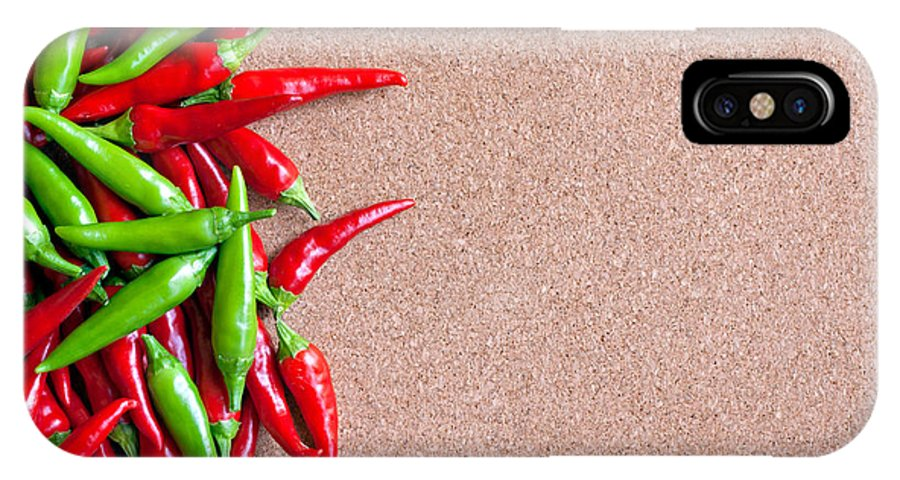 Mexican IPhone X Case featuring the photograph Ripe Red And Green Chillies On Cork Board by Ken Biggs