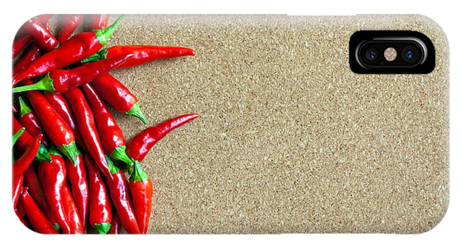 Mexican IPhone X Case featuring the photograph Ripe Red Chillies On Cork Board by Ken Biggs