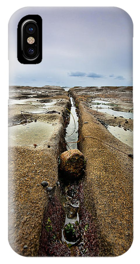 Beach IPhone X Case featuring the photograph Rock And A Hard Place by Peter Tellone