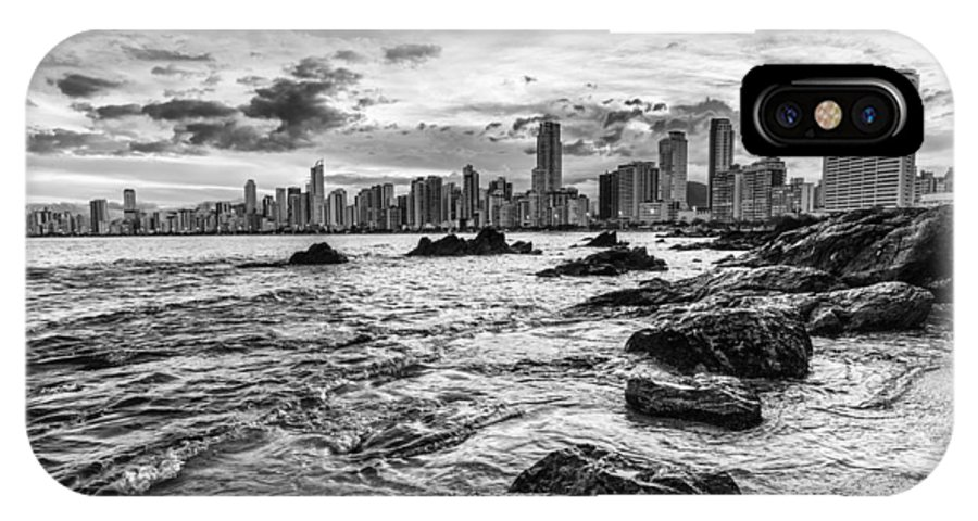 City IPhone X / XS Case featuring the photograph Rocks By The Sea by Jose Maciel