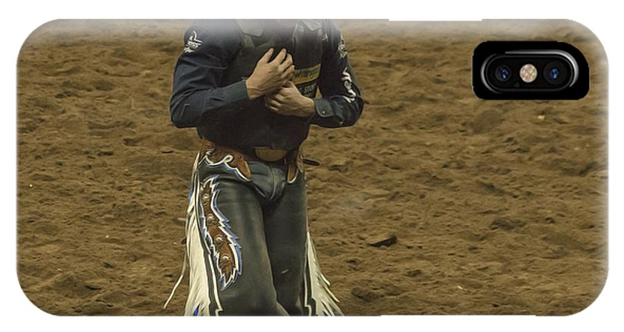 Rodeo IPhone X Case featuring the photograph Rodeo Cowboy Dusting Off by Janice Pariza