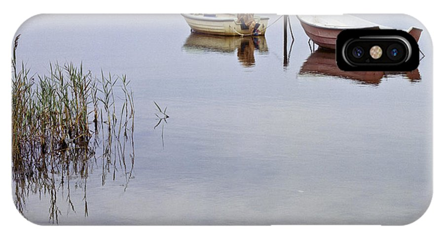 Heiko IPhone X Case featuring the photograph Rowboats On Nonnensee by Heiko Koehrer-Wagner