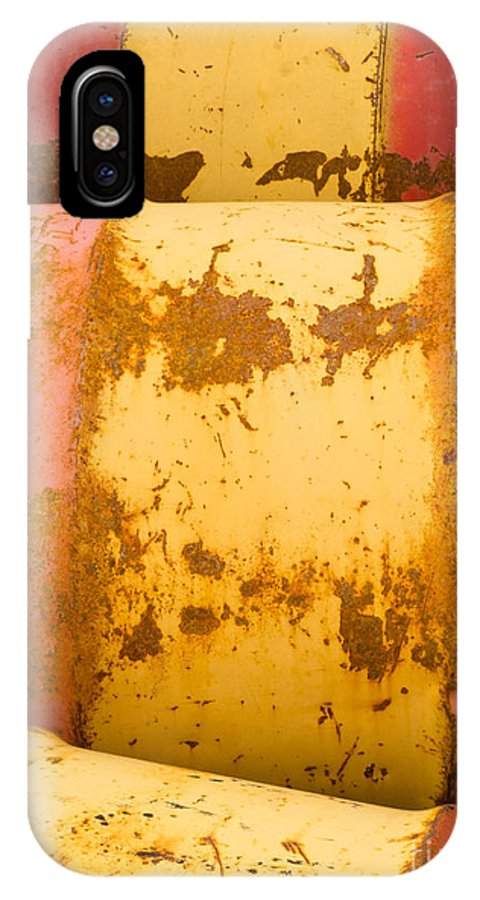 Abstract IPhone X Case featuring the photograph Rusty Oil Barrels Yellow Red Background Pattern by Stephan Pietzko