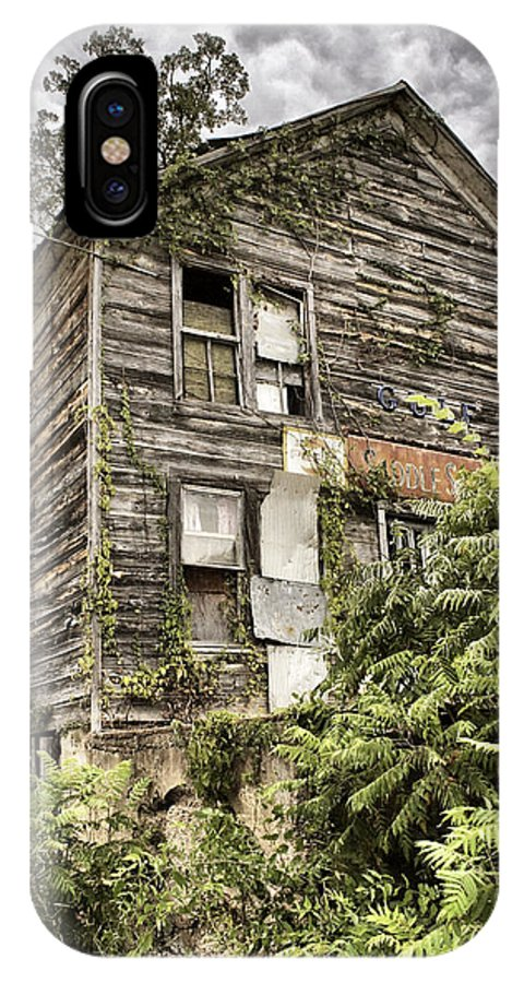 Rustic IPhone X Case featuring the photograph Saddle Store 2 Of 3 by Jason Politte