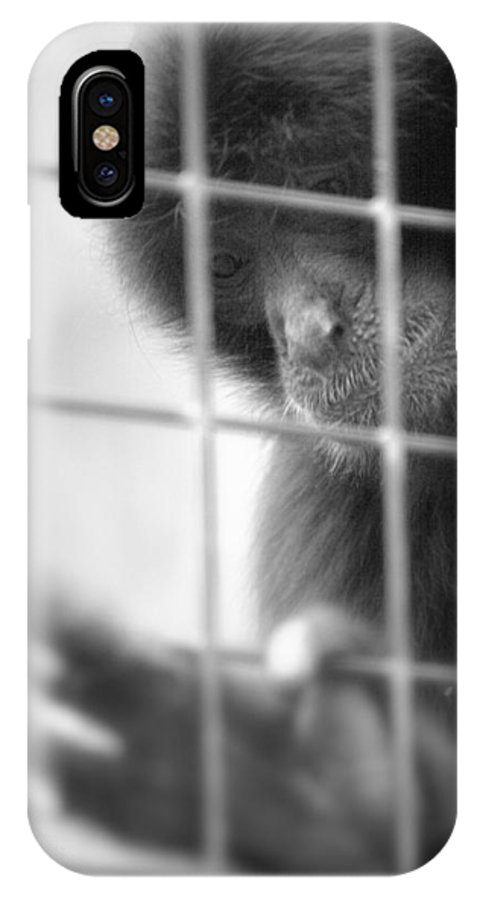 Primate IPhone X Case featuring the photograph Sadness by Roger Parker