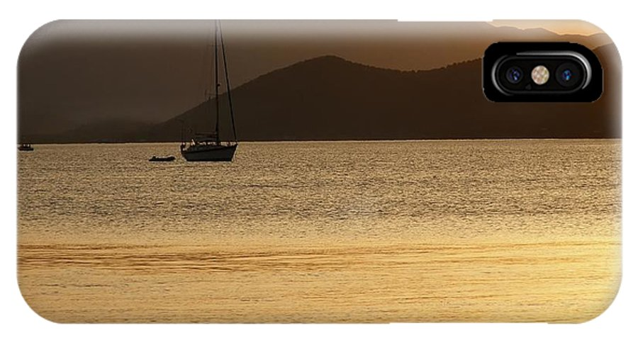 Sunset IPhone X Case featuring the photograph Sailboat At Sunset by Sophie Vigneault