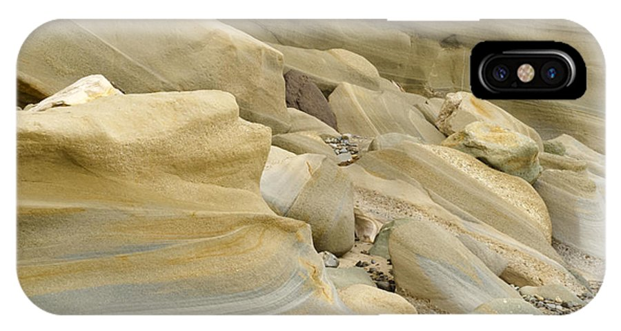 Banded IPhone X Case featuring the photograph Sandstone Sediment Smoothed And Rounded By Water by Stephan Pietzko