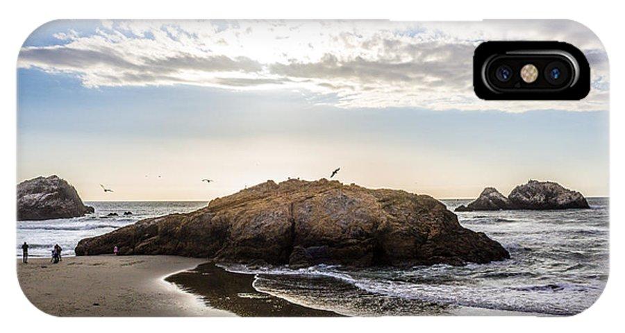 Ocean IPhone X Case featuring the photograph Setting Sun Against Rocks Near San Francisco Ca Cliff House by Glen Laughton