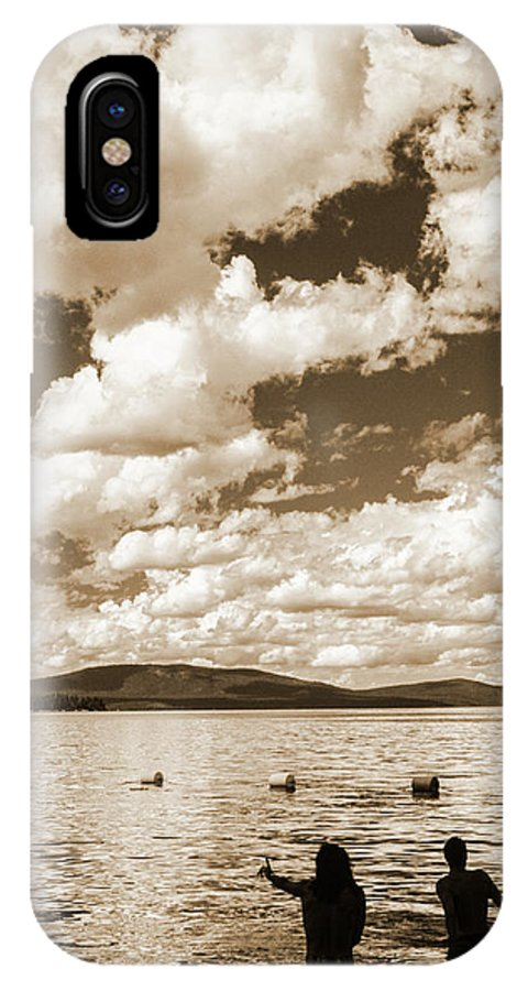 Vertical IPhone X Case featuring the photograph Silhouette Of People Standing In Lake by Ron Koeberer