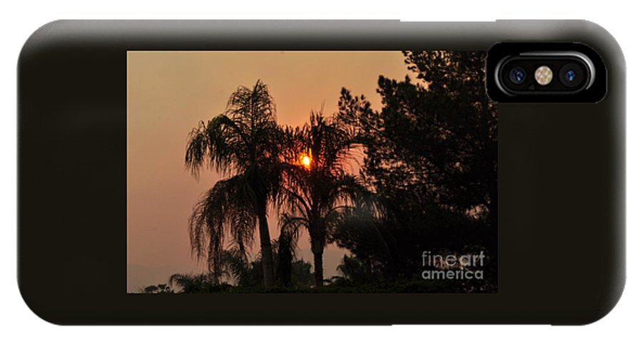 Sky IPhone X Case featuring the photograph Smoke Covered Sky Sunset Thru The Palm Trees by Jay Milo