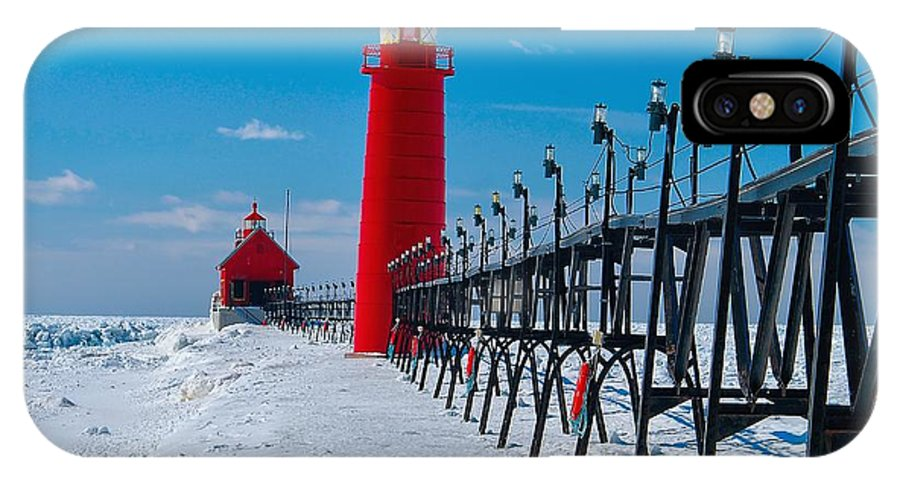 Lighthouse IPhone X Case featuring the photograph Snowy Grand Haven Pier by Nick Zelinsky