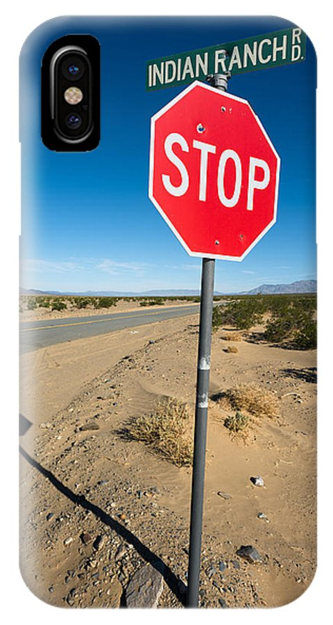 America IPhone X / XS Case featuring the photograph Stop Sign On Indian Ranch Road In Death Valley by Alyaksandr Stzhalkouski