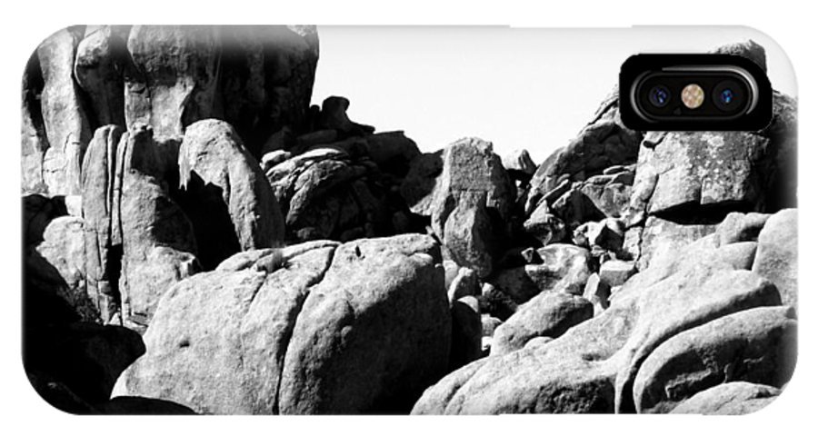 Jtnp IPhone X Case featuring the photograph Story Told By The Rocks by Carolina Liechtenstein