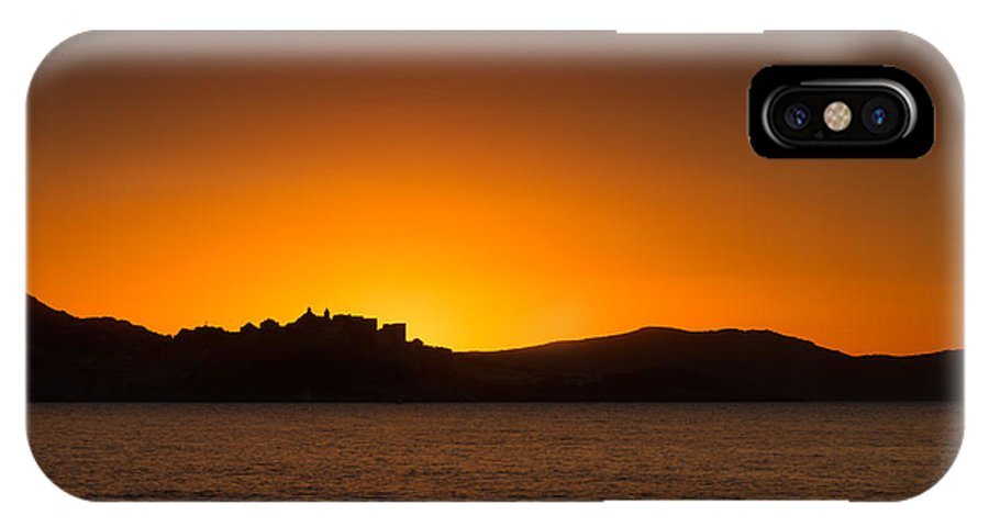 Balagne IPhone X Case featuring the photograph Sun Setting Behind Calvi Citadel In Corsica by Jon Ingall