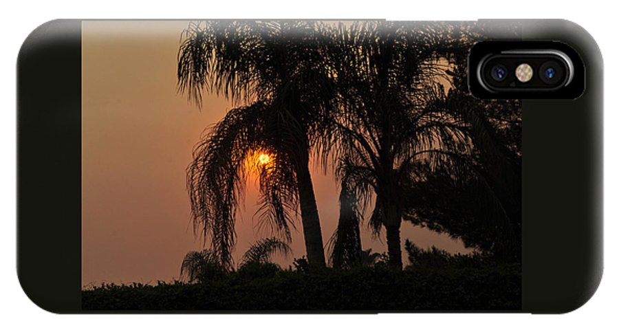 Fire IPhone X Case featuring the photograph Sun Setting Behind The Queen Palm Covered In Smoke by Jay Milo