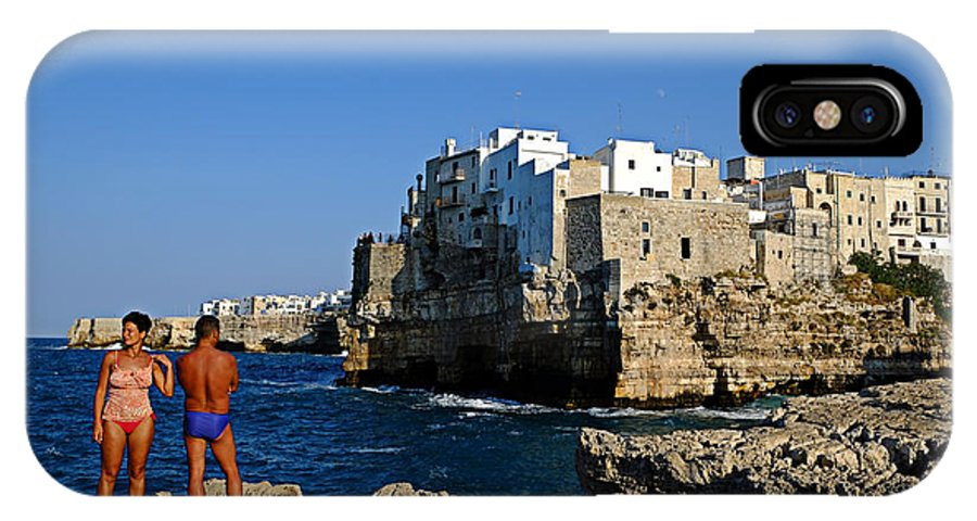 Polignano A Mare IPhone X Case featuring the photograph Sunbathing At Polignano A Mare by Gianmarco Cicuzza