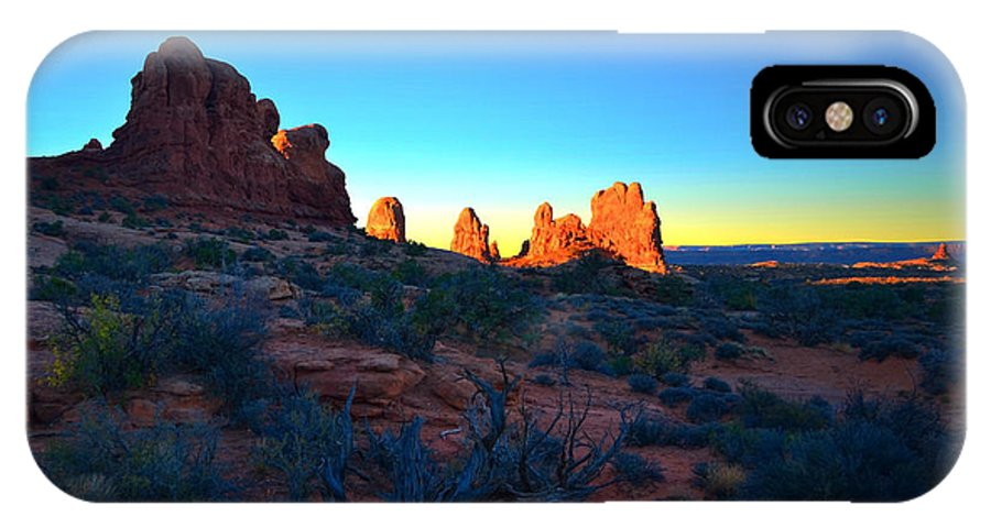 Sunrise IPhone X Case featuring the photograph Sunrise At Arches National Park by Tara Turner