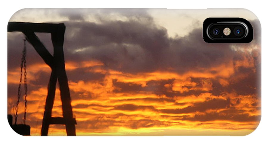 Silhouetted Swing-set Against The Sunset IPhone X Case featuring the photograph Sunset Swing by Debra Schultz