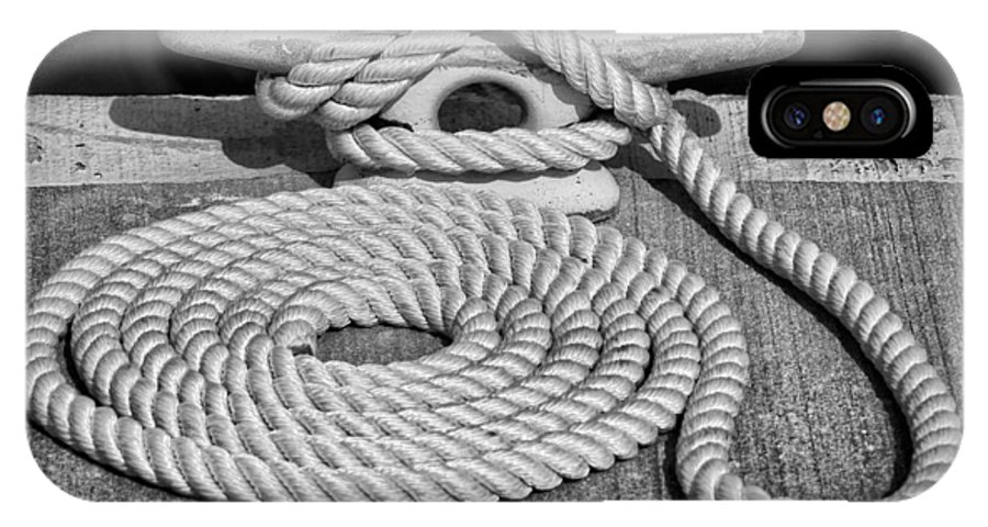 Dock IPhone X Case featuring the photograph The Art Of Rope Lying by Nikolyn McDonald
