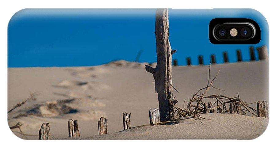 Sand IPhone X / XS Case featuring the photograph The Lonely Driftwood by Trish Tritz