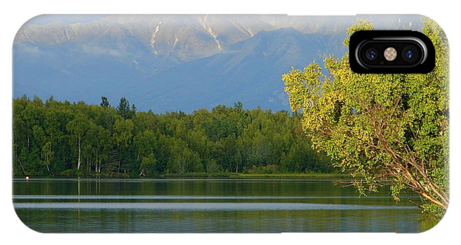 Mountain IPhone X Case featuring the photograph The Mountain Guards The River by Lew Davis