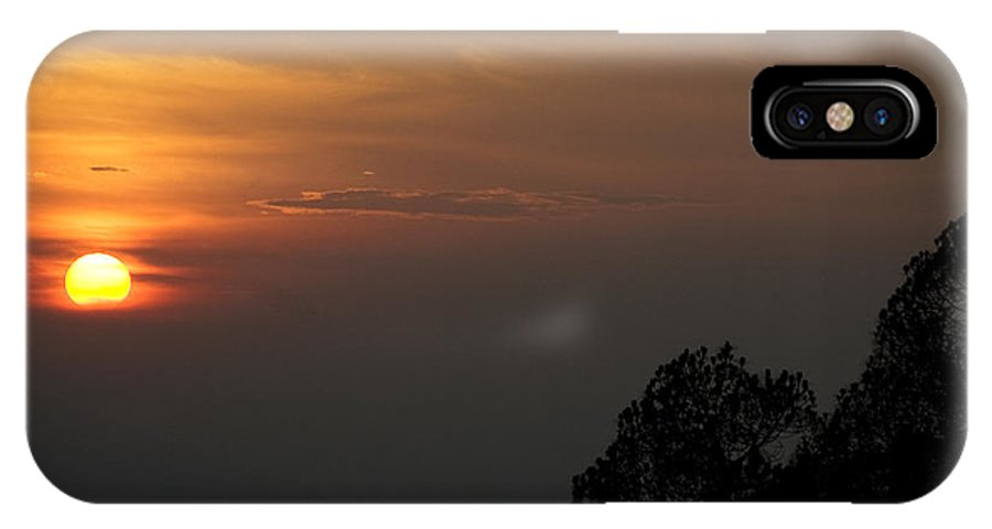 Landscape IPhone X Case featuring the photograph The Sun Behind The Trees by Rajiv Chopra