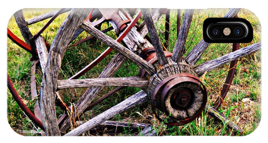 An Old Piece Of Farm Equipment Is Slowly Returning To Nature In The Ozarks Of Missouri. IPhone X Case featuring the photograph Thrasher Past by Marty Koch