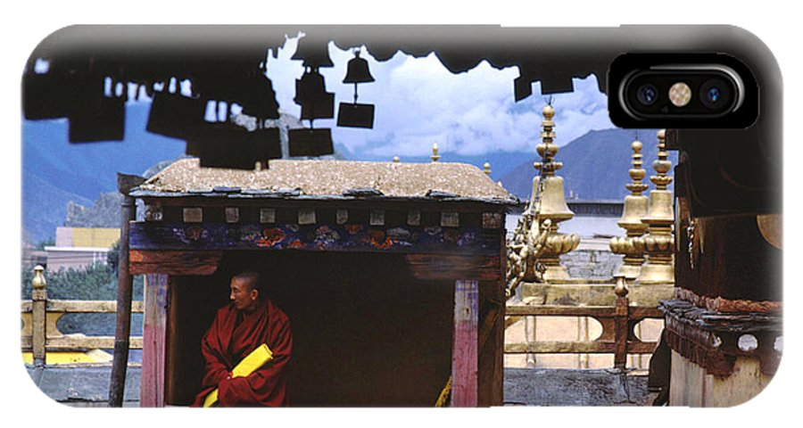 Tibet IPhone Case featuring the photograph Tibetan Monk With Scroll On Jokhang Roof by Anna Lisa Yoder